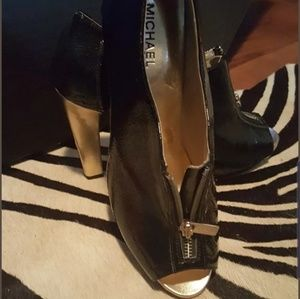 Michael Kors patent black and gold booties
